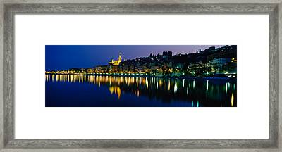 Reflection Of Buildings In Water Framed Print