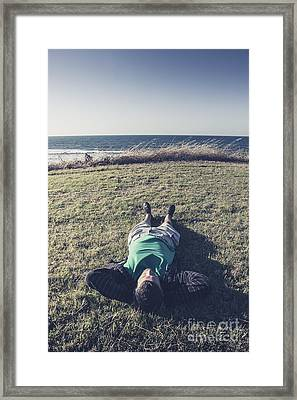 Relaxing Man Laying Down On Tasmanian Coast Field Framed Print by Jorgo Photography - Wall Art Gallery