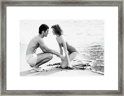 Rene Russo With A Man On A Beach Framed Print