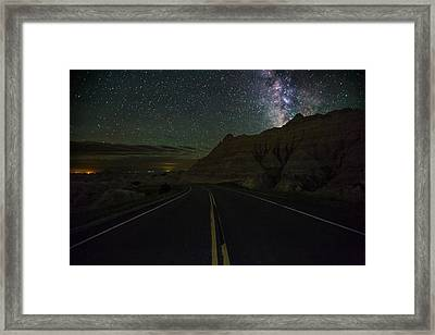 Ride Across The Badlands  Framed Print by Aaron J Groen