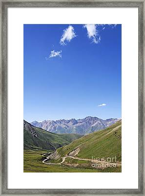 Road Winding Through Mountainous Central Kyrgyzstan Framed Print by Robert Preston