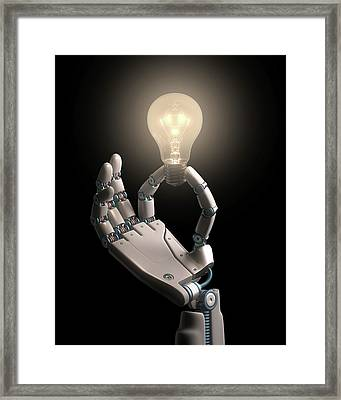 Robotic Hand Holding A Light Bulb Framed Print by Ktsdesign
