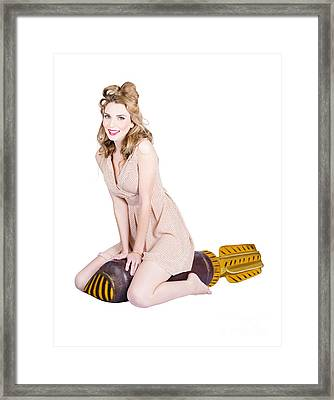Rocket Girl. Retro Pin Up Model On War Missile Framed Print by Jorgo Photography - Wall Art Gallery