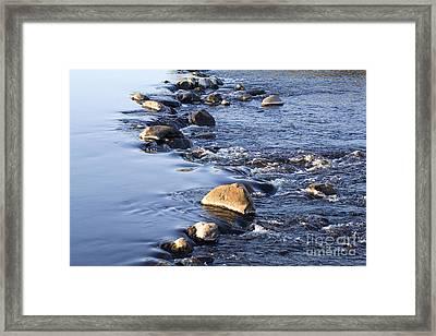 Rocks In A Weir Framed Print by Liz Leyden