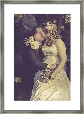 Romantic Bride And Groom Kissing Outdoors Framed Print