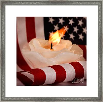 Rose Candle On American Flag Framed Print by Iris Richardson