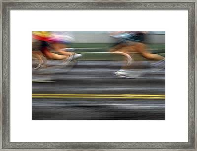Runners Blurred Framed Print by Jim Corwin