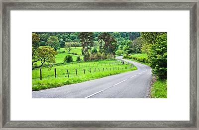 Rural Road Framed Print by Tom Gowanlock