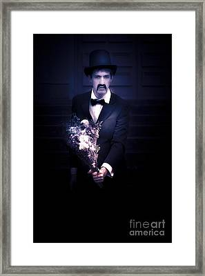 Sad Man Holding Flowers Framed Print
