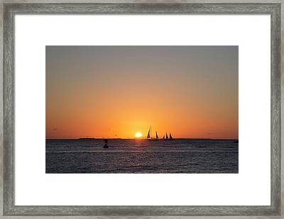 Sailing Boats At Sunset Framed Print by Jim West