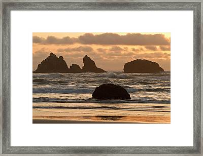 Sea Stacks On The Beach At Bandon Framed Print by William Sutton