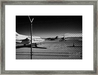 Security Chain Link Fencing With Warning Restricted Area Sign On The Perimeter Of Mccarran Airport Framed Print by Joe Fox