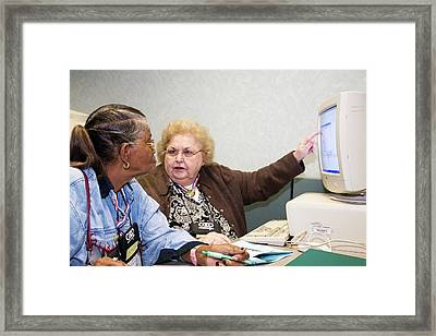 Senior Citizen Learning To Use Computer Framed Print