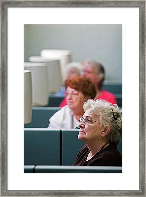 Senior Citizens Learning To Use Computers Framed Print