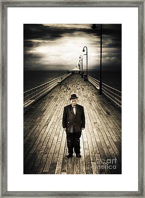 Senior Male Standing On A Pier Promenade Framed Print