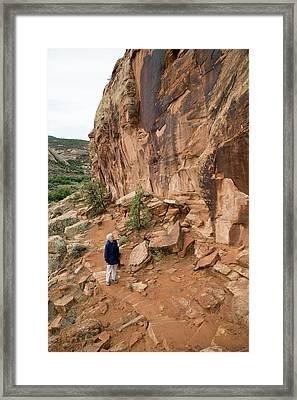 Senior Woman Hiking Framed Print by Jim West