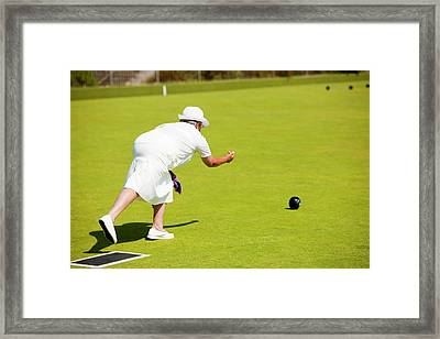 Seniors Playing Bowls At Penzance Framed Print by Ashley Cooper