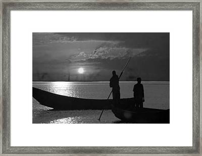 Serenity Of The Nature In Congo 2 Boat Men Calling It A Day At The Sunset Who Knew It Could Be So Pe Framed Print by Navin Joshi