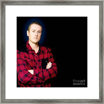 Serious Male Worker On Dark Blue Background Framed Print by Jorgo Photography - Wall Art Gallery