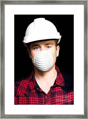 Serious Young Male Artisan Wearing Protective Mask Framed Print by Jorgo Photography - Wall Art Gallery
