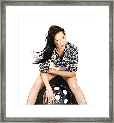 Sexy Woman Sitting On Car Tyre Framed Print