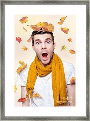 Shocked Man Playing In Falling Autumn Leaves Framed Print
