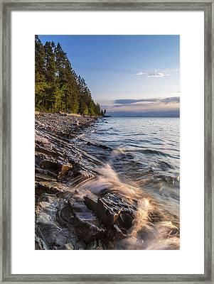 Shoreline Of Flathead Lake Receives Framed Print by Chuck Haney