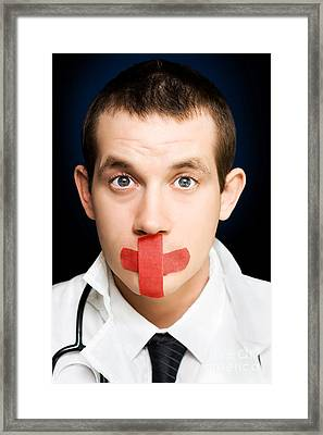 Silent Handsome Doctor With Cross Bandage On Face Framed Print by Jorgo Photography - Wall Art Gallery