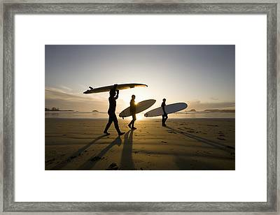 Silhouette Of Three Surfers Carrying Framed Print