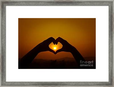 Silhouettes Hand Heart Shaped Framed Print by Tosporn Preede