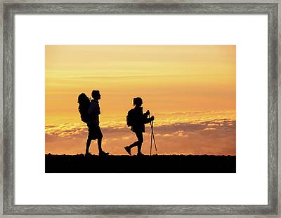 Silhouettes Of Two Hikers Framed Print