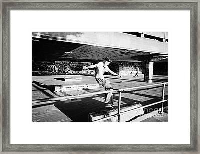 skateboarder at the undercroft skate park of the southbank centre London England UK Framed Print