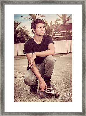 Skateboarder Man Kneeling Down On Deck Framed Print
