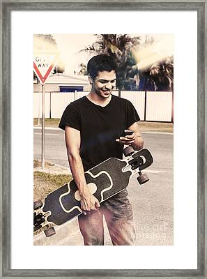 Skater Boy Sending Txt Message With A Smart-phone Framed Print by Jorgo Photography - Wall Art Gallery