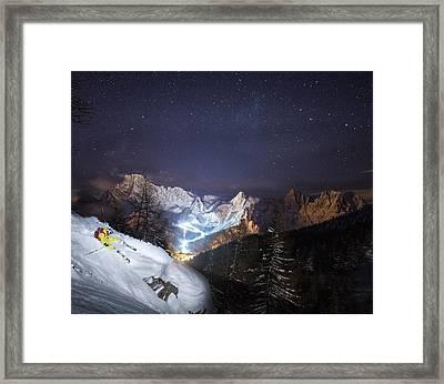 Skier Riding Down A Powder Slope At Night Framed Print by Leander Nardin
