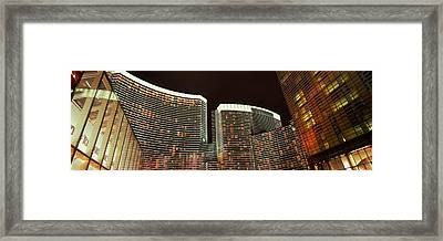 Skyscrapers Lit Up At Night Framed Print