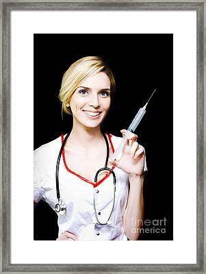 Smiling Female Doctor With Big Syringe Framed Print by Jorgo Photography - Wall Art Gallery