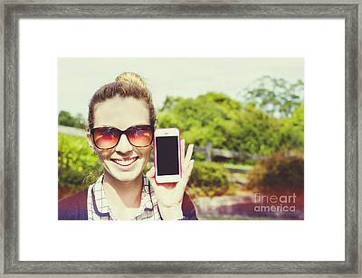 Smiling Person Showing Cell Phone Handset   Framed Print by Jorgo Photography - Wall Art Gallery