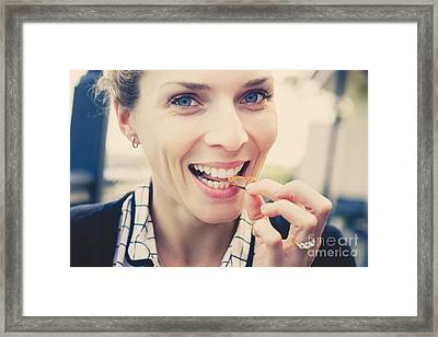 Smiling Woman Eating Chocolate With Caramel Centre Framed Print by Jorgo Photography - Wall Art Gallery
