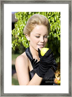 Smiling Woman With Apple Framed Print by Jorgo Photography - Wall Art Gallery