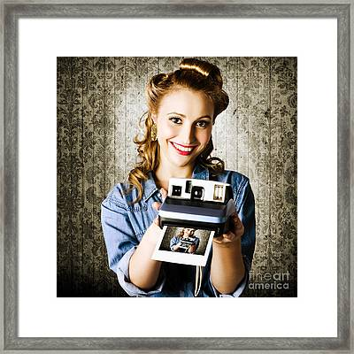 Smiling Young Vintage Girl Taking Polaroid Photo Framed Print by Jorgo Photography - Wall Art Gallery