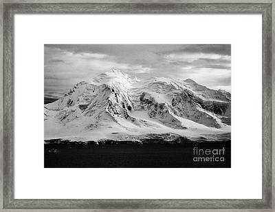 snow covered landscape of anvers island mountain range and neumayer channel Antarctica Framed Print by Joe Fox