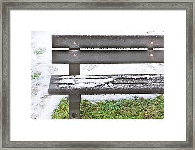 Snow On Bench Framed Print