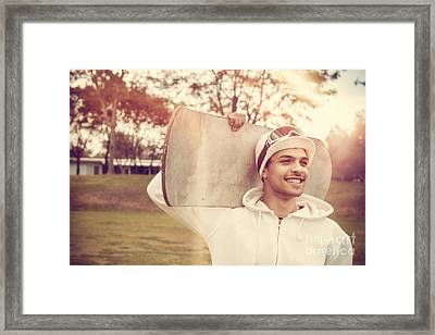 Snowboarding Man Smiling While Holding Snowboard Framed Print by Jorgo Photography - Wall Art Gallery