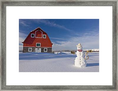 Snowman Dressed Up As A Cowboy Standing Framed Print by Kevin Smith