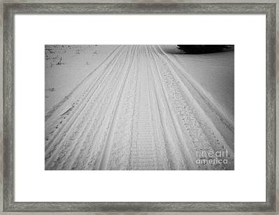 snowmobile tracks in the snow Kamsack Saskatchewan Canada Framed Print