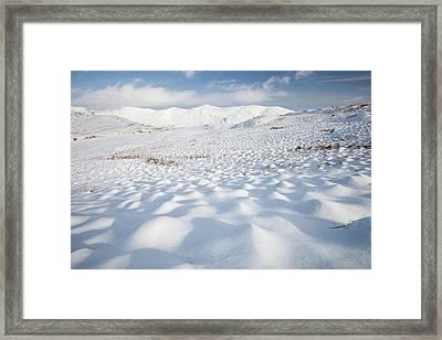 Snowy Hummocks Framed Print