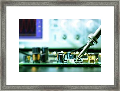 Soldering An Circuit Board Framed Print
