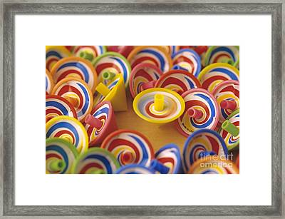 Spinning Tops Framed Print by Jim Corwin