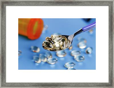 Spoon With Capsules Framed Print